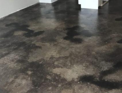 Black acid stained concrete kitchen floor