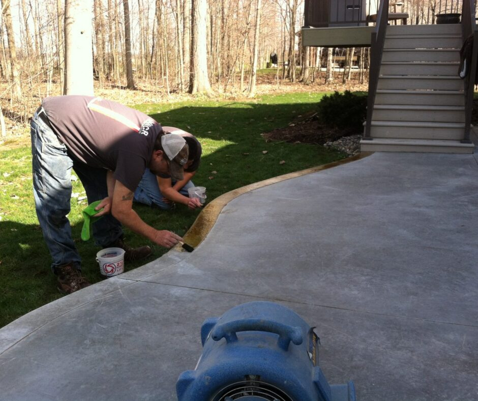 Applying Black Acid Stain to Outdoor Concrete