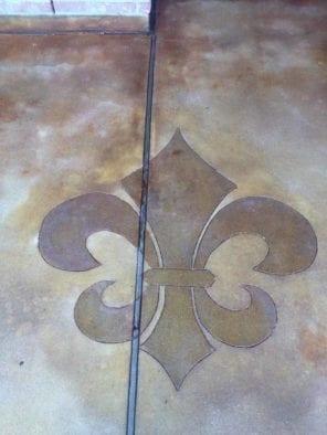 Coffee Brown Acid Stain Sprayed Onto Concrete Stencil Cut