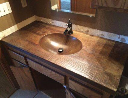 Bathroom concrete vanity stained to look like wood