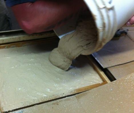 Pouring Concrete Countertop Mix into Form