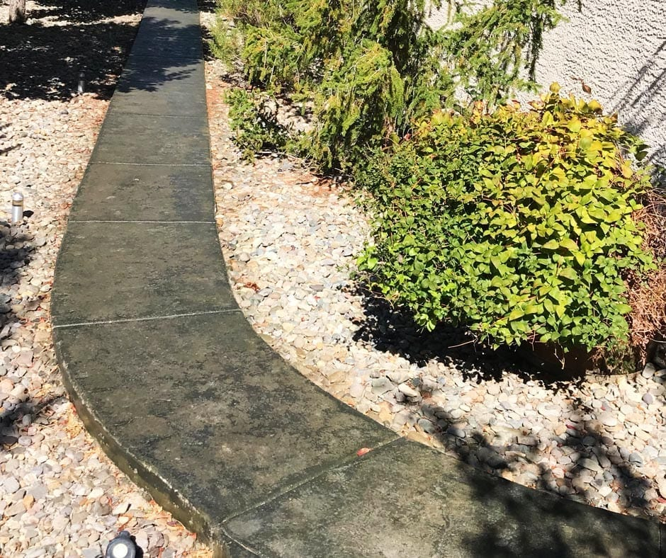 Concrete Walkway Stained with Olive and Black Antiquing Stains. Sealed with Satin Finish Solvent Based Acrylic Concrete Sealer