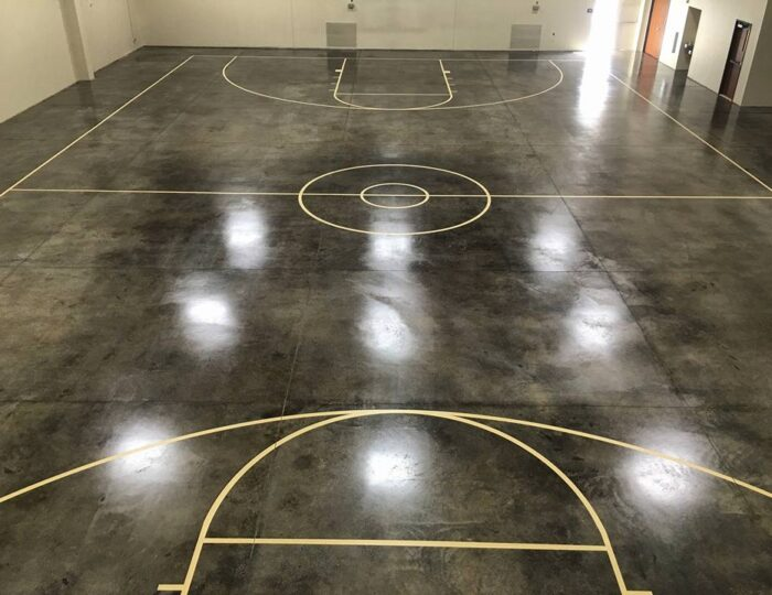 Black Concrete Acid Stained Indoor Basketball Court