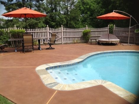Pool deck stained with Cumin and Russet Antique Stains and sealed with an acrylic concrete sealer