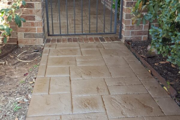 Stamped concrete walkway stained with Driftwood Satin, Solvent-Based Tinted Sealer.