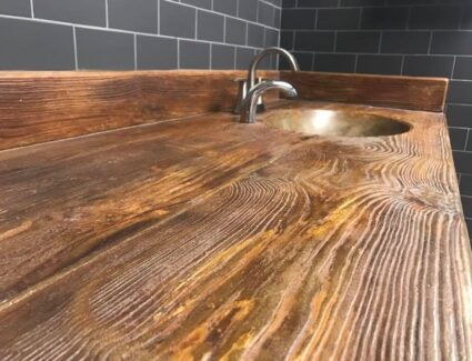 Concrete vanity stained to look like wood