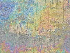 Oil Spill Rainbow Sheen on Concrete