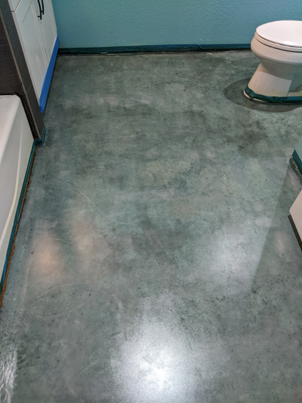 Stained Concrete Bathroom Floor with Azure Blue Acid Stain
