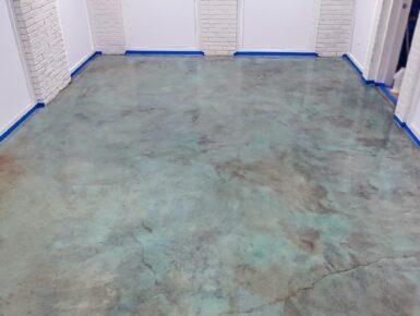 Blue Acid Stained Concrete Basement Floor