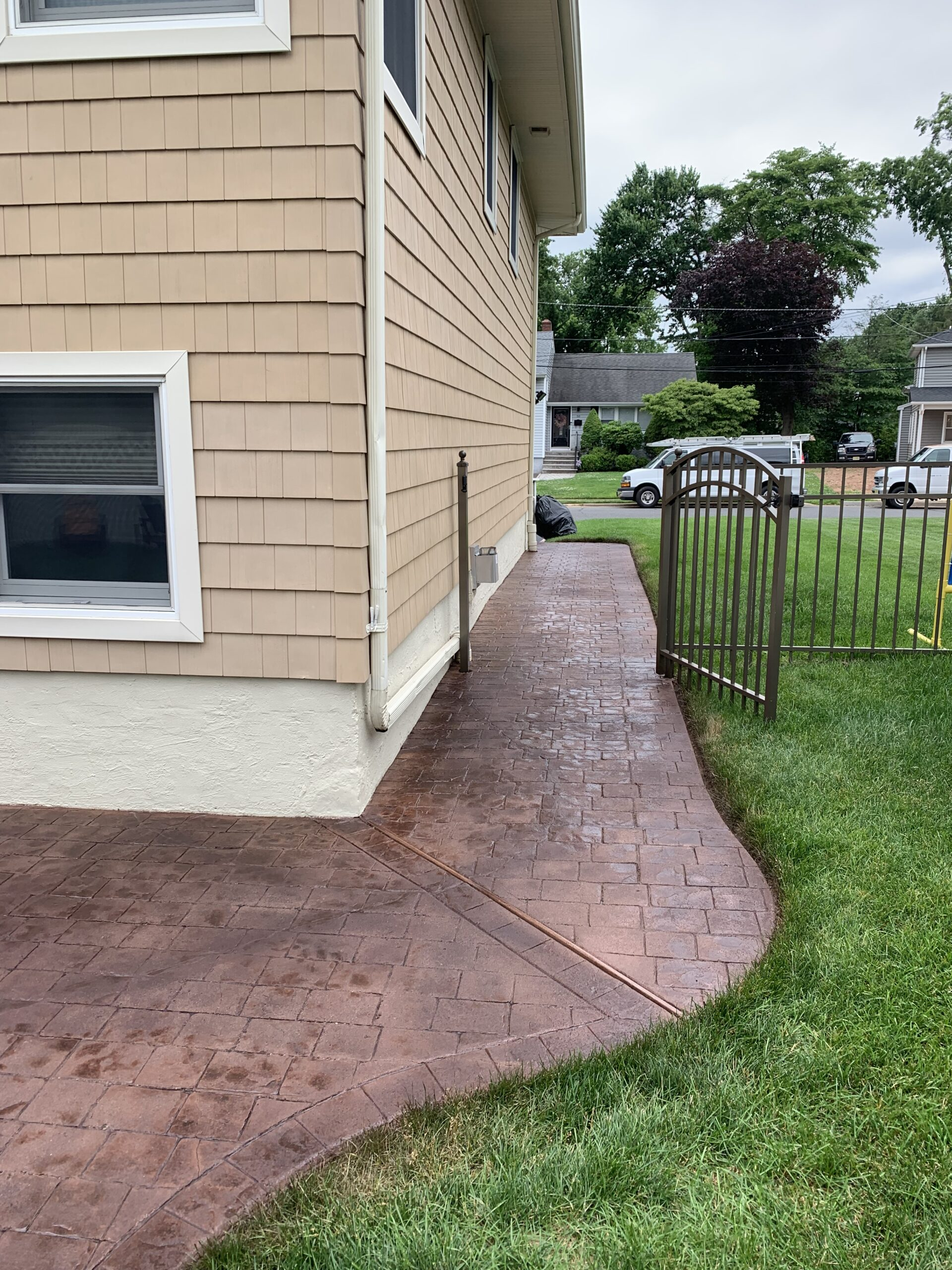 Patched Stamped Concrete Patio After Applying Aztec Brown Antiquing Stain