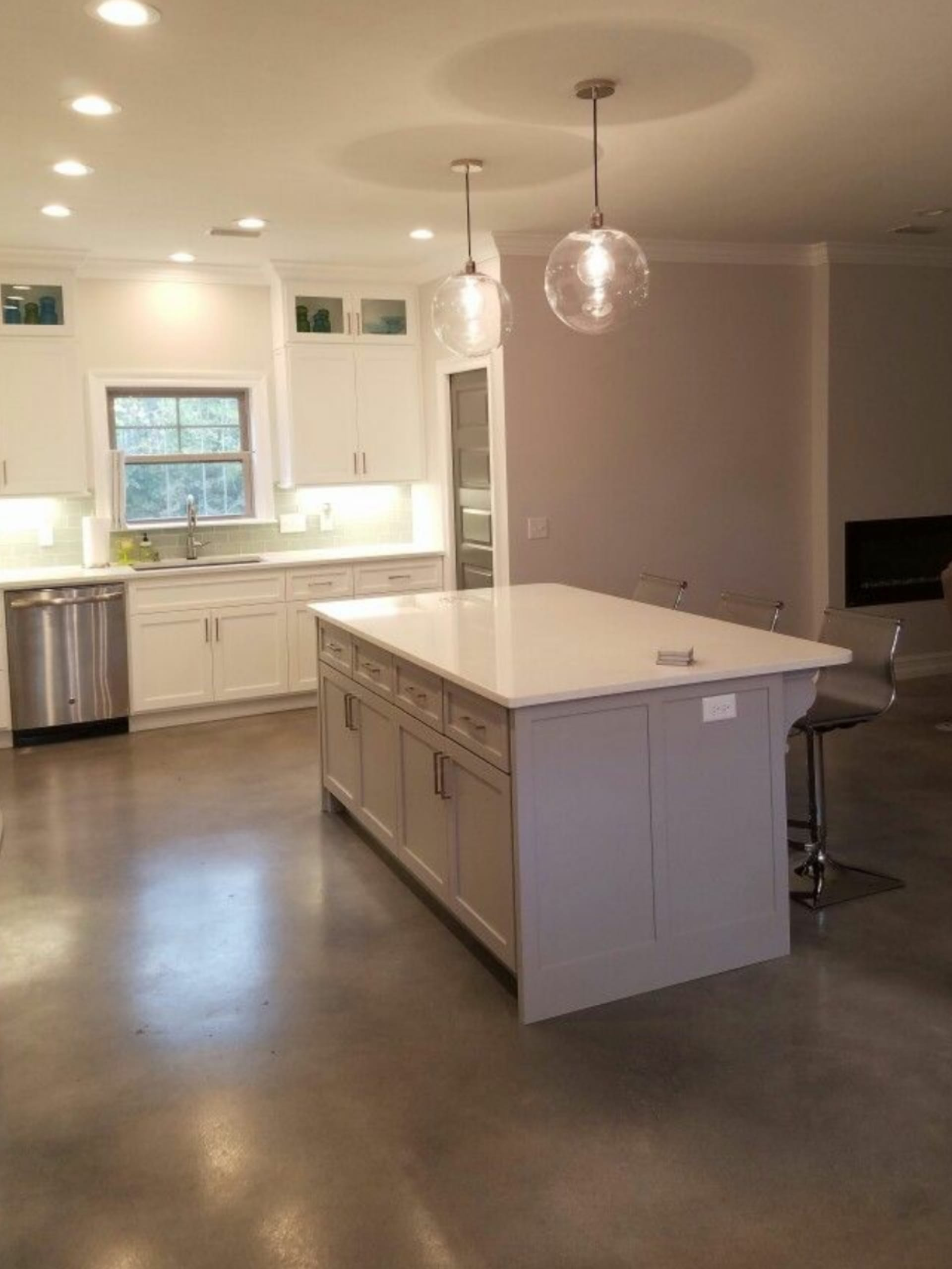 Stormy gray, white, charcoal, light slate concrete dye stained kitchen floor