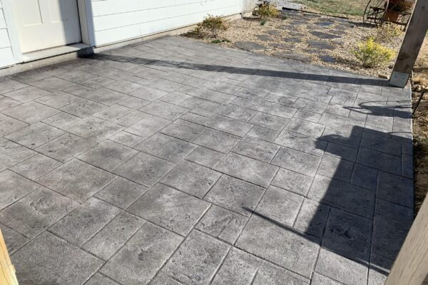 Stamped concrete driveway stained with Charcoal Gray Antiquing Stain