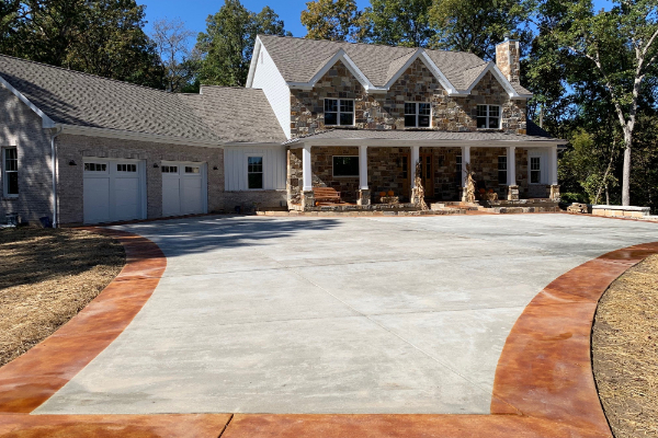 Brushed concrete driveway stained with EverStain Cola acid stain