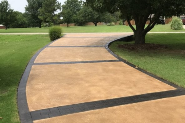 Concrete driveway stained with Yukon Gold Antiquing Stain and Black EasyTint