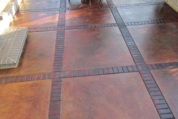 Cola Acid Stained with Rust Vibrance Dye Border - Concrete Patio