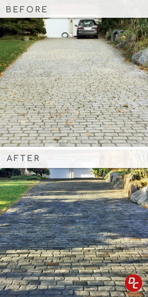 Concrete driveway stained to mimic an old cobblestone street of various grays with sporadic accent stones of natural stone colors in earth tones