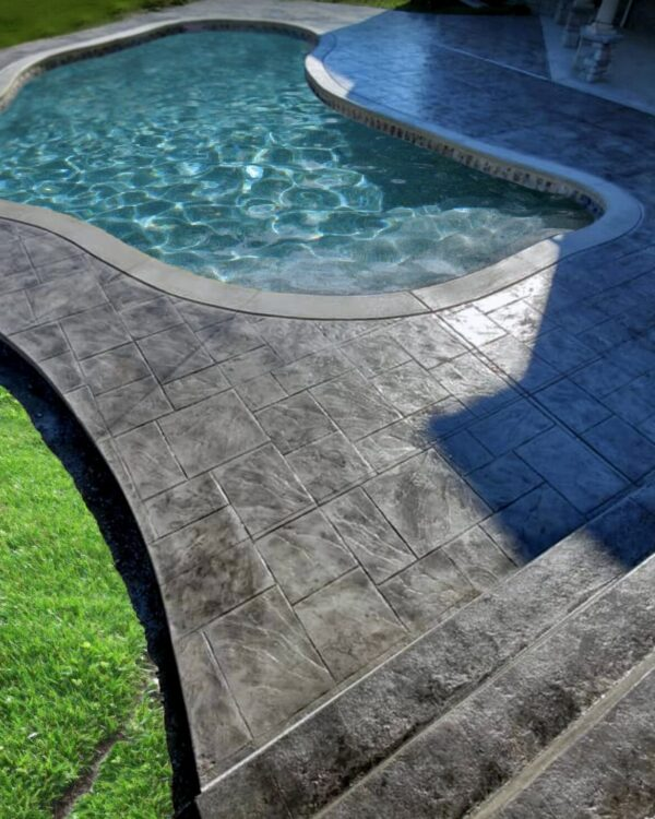 black stained and sealed stamped concrete pool deck
