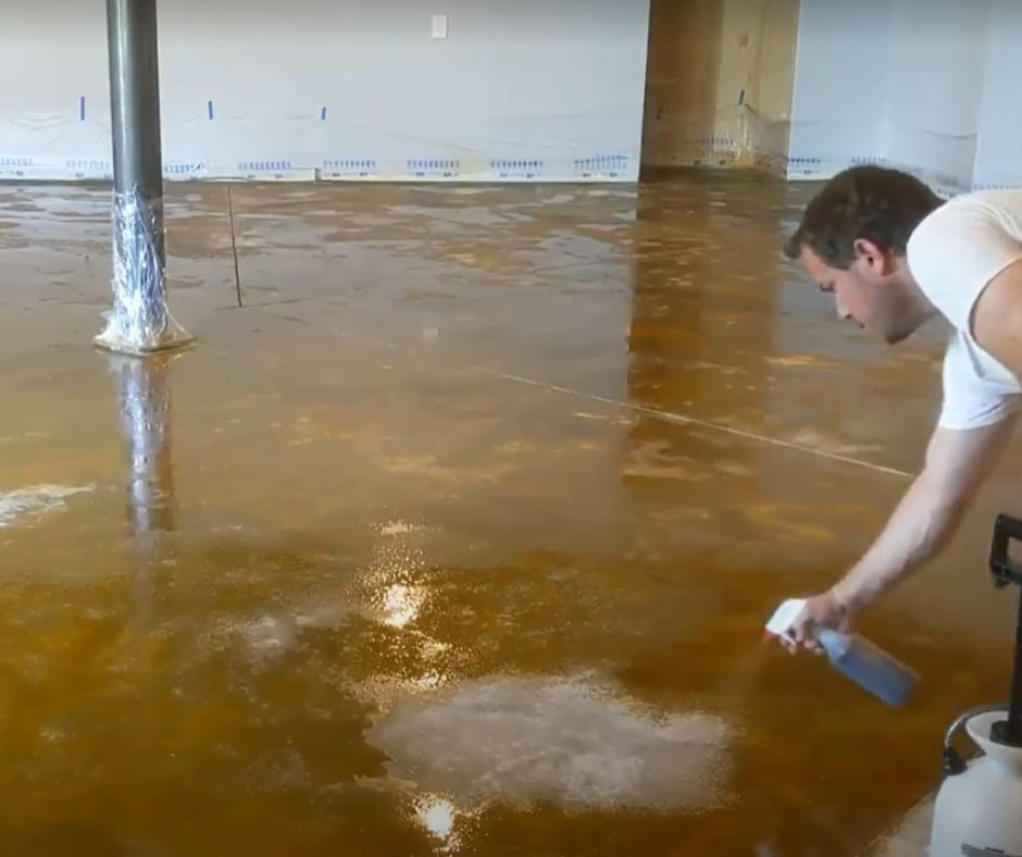 Apply base acid stain color with pump-up sprayer