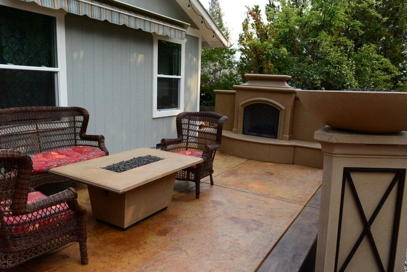 A backyard patio colored using concrete stain instead of concrete paint.