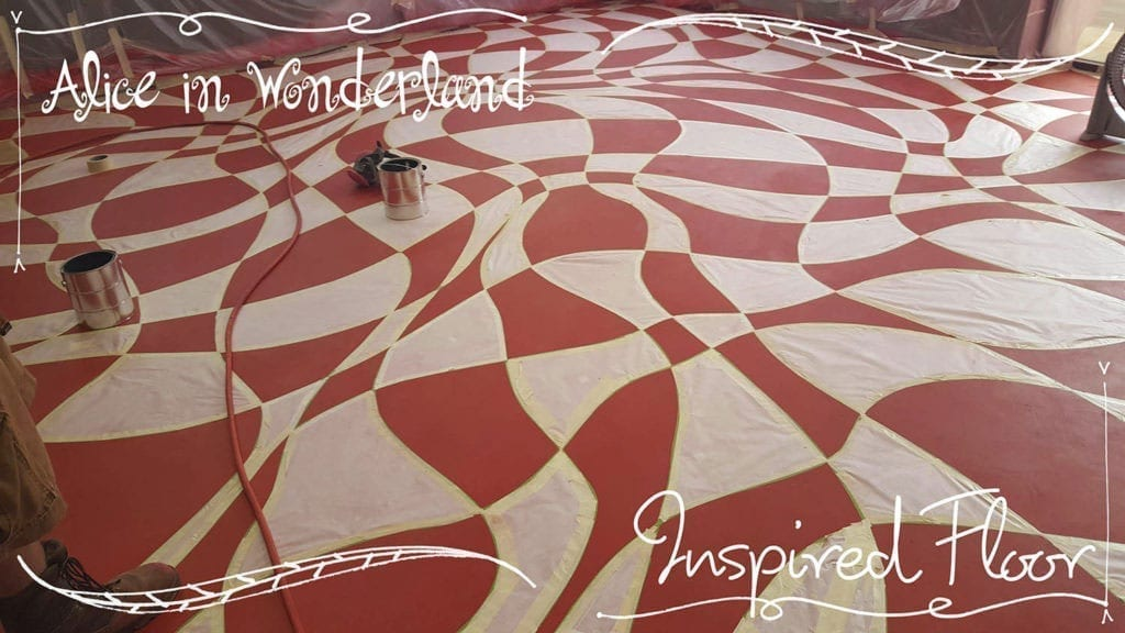 A concrete floor colored with concrete dye inspired by Lewis Carrol's Alice in Wonderland.