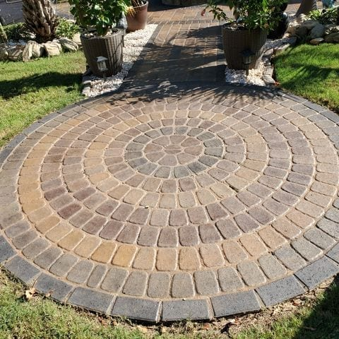 Cumin, Driftwood and Black Stamped Concrete Patio