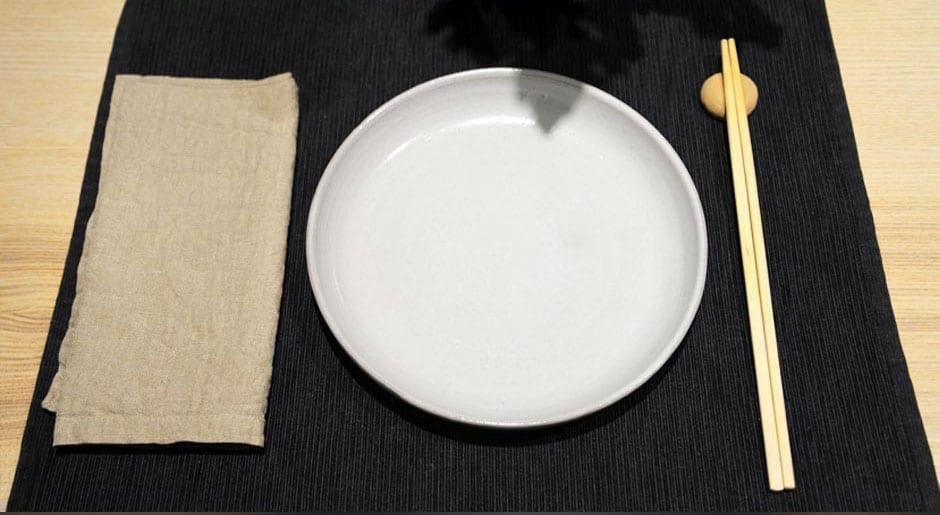 A table set complete with chopsticks and a DIY concrete chopstick holder.