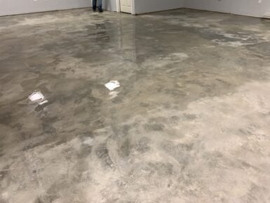 Allow concrete floor to dry before colored concrete sealer application