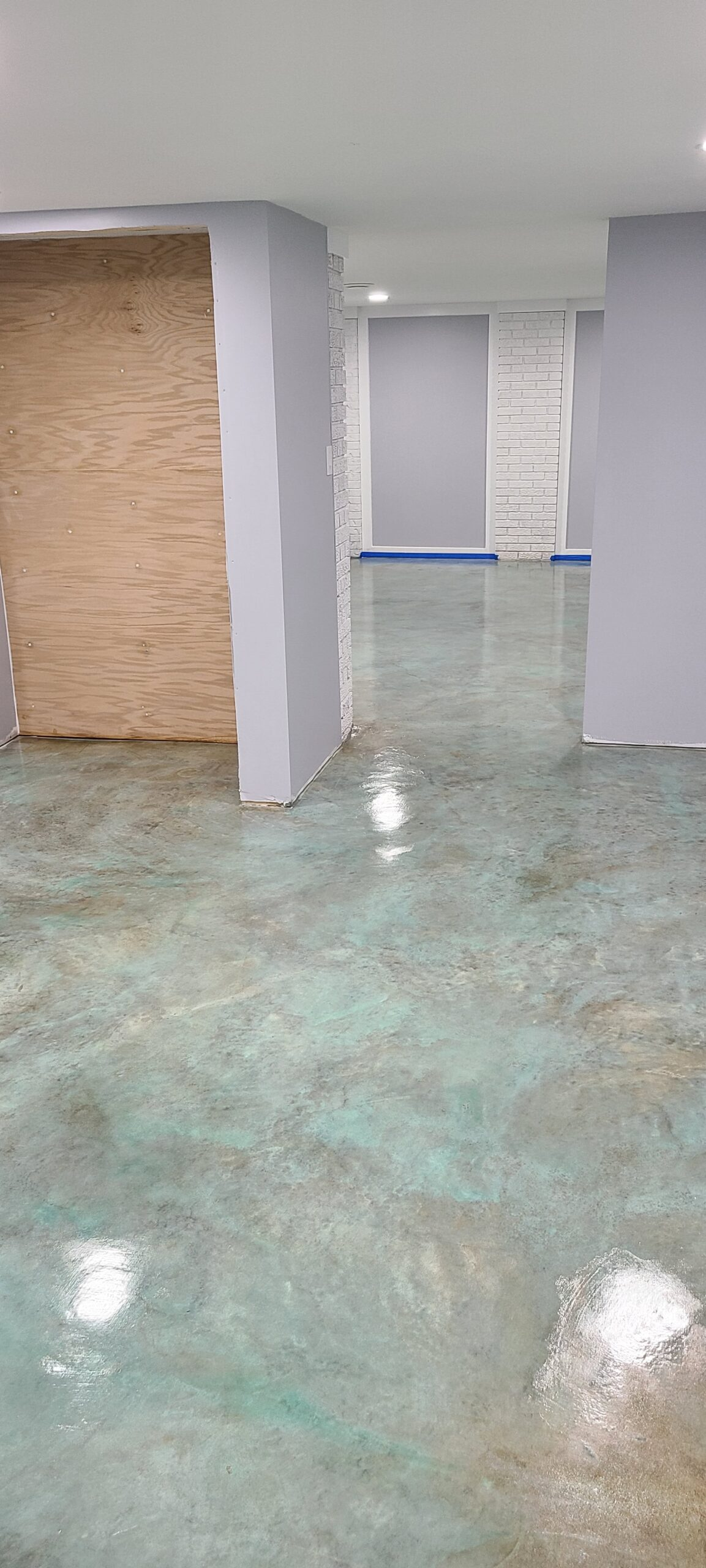 Stained Concrete Floor with Azure Blue Acid Stain